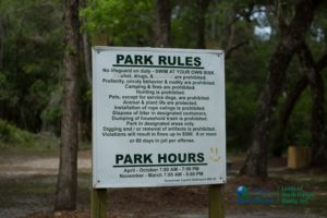 A list of rules of the Royal Springs Park, along with the hours.