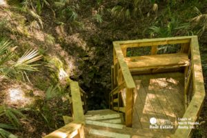 A wooden stairwell leads down into an underground cave for divers called Martz Sink