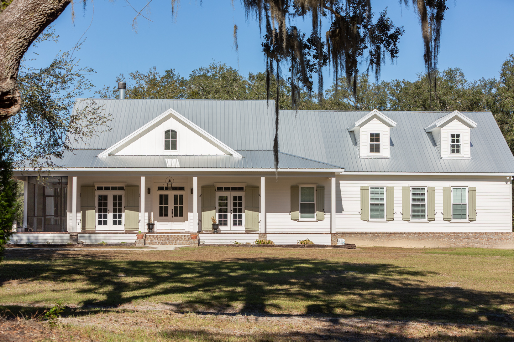 Home with front porch and metal roof